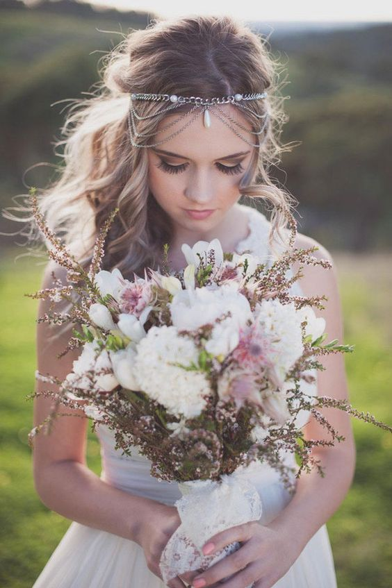 a boho chain headpiece with pearls and some layers bring an instant boho feel