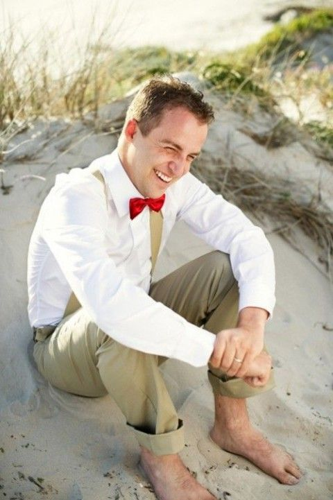 a no jacket look with suspenders and tan pants with a red bow tie for a beach look
