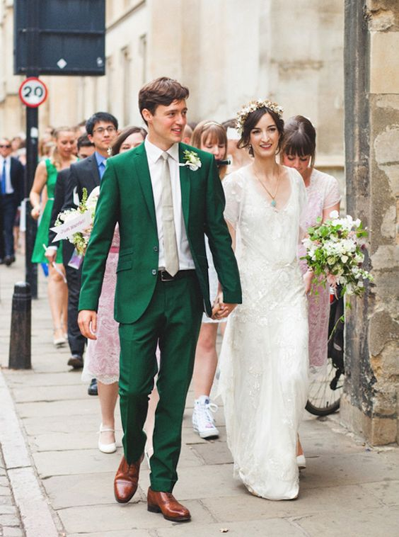an emerald suit with a nude tie and brown shoes for a stylish vintage inspired wedding