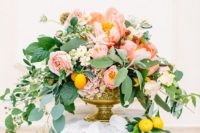 16 a chic and colorful peony centerpiece with pink and white blooms, cascading greenery and lemons