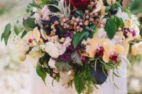 16 a forest wedding bouquet with yellow orchids, greenery and many textural elements for a wild look