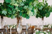 16 a lush and oversized tall foliage centerpiece is a wow solution that makes indoors feel like outdoors