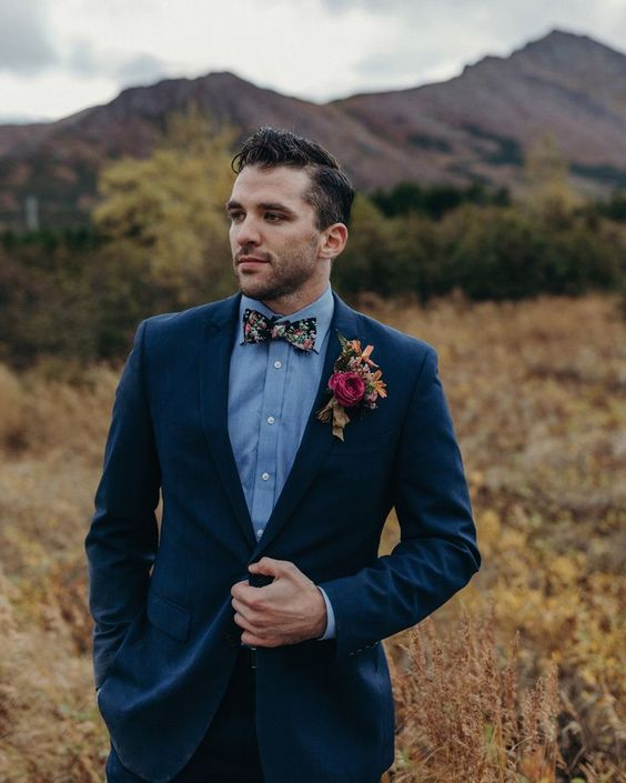 a navy suit, a chambray shit, a floral bow tie for a boho fall groom's look