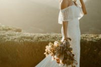 16 an amazing polka dot off the shoulder sheath wedding gown with a long train and sheer detailing