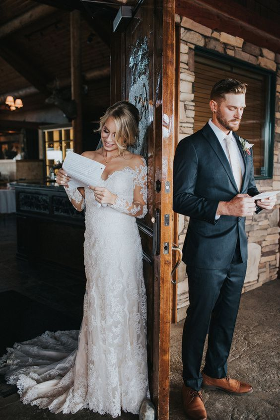 a super romantic off the shoulder lace fitting wedding gown with long illusion sleeves and a train