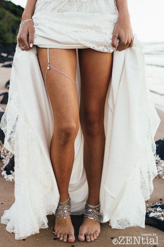 layered chain anklets and a matching garter with a rhinestone for a beach boho bride