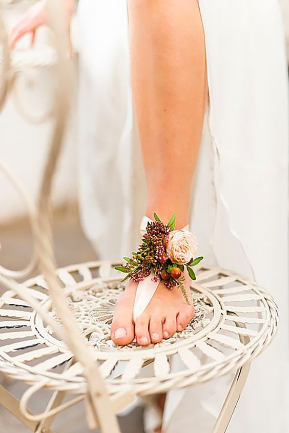 a floral barefoot sandal with blush and burgundy blooms for a delicate bridal look