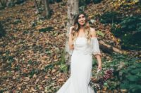 18 a flowy off the shoulder mermaid plain wedding dress with lace edges is ideal for a summer boho bride