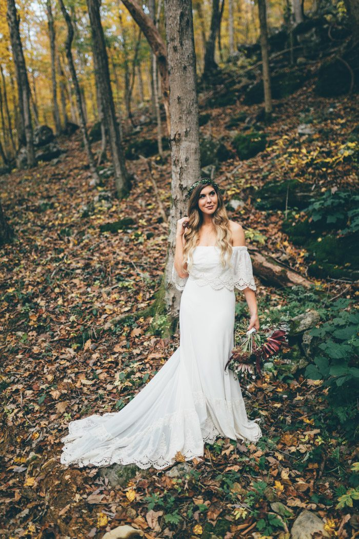 a flowy off the shoulder mermaid plain wedding dress with lace edges is ideal for a summer boho bride
