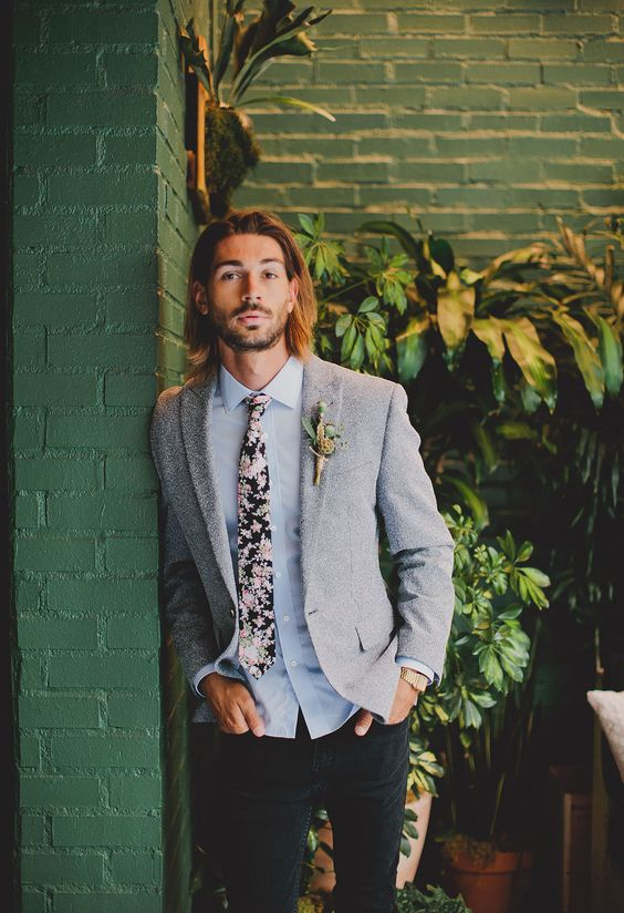 black jeans, a grey shirt, a grey jacket and a pink floral tie for a relaxed and casual groom's look