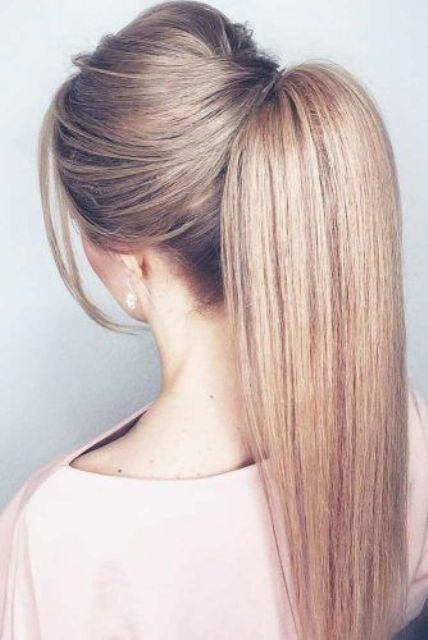 a high ponytail with a bump, bangs and sleek yet voluminous hair looks very modern