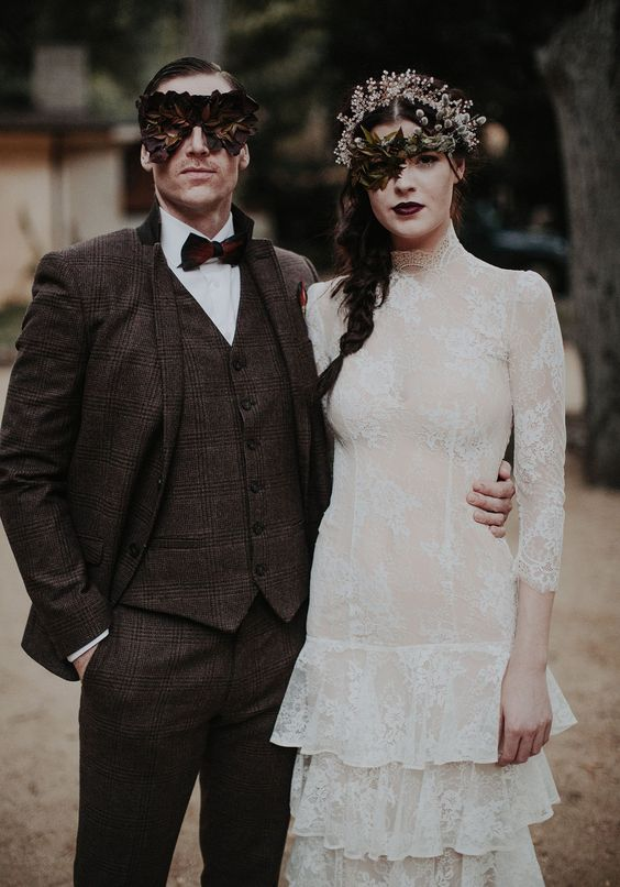a brown three-piece tweed suit, a white shirt and a burgundy bow tie for a haunted Halloween wedding