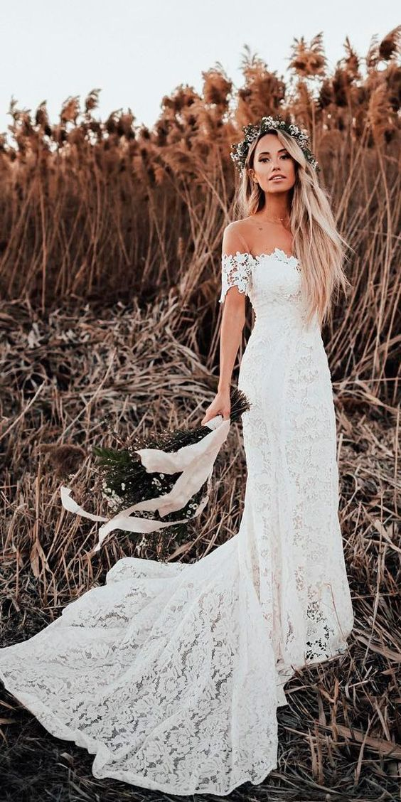 a lace sheath of the shoulder wedding dress with a train is ideal for a boho bride