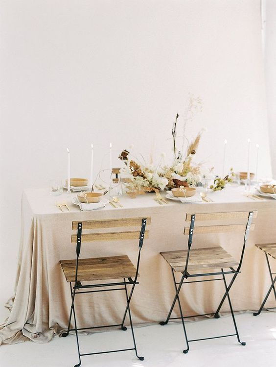 a soft-colored taupe tablecloth, touches of natural wood and grasses for a naturally beautiful look