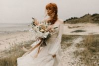 21 a flowy and ethereal off the shoulder lace A-line wedding gown with long sleeves and a layered skirt