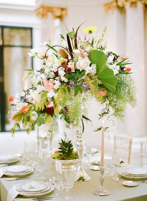 Picture of a tall super lush tropical wedidng centerpiece
