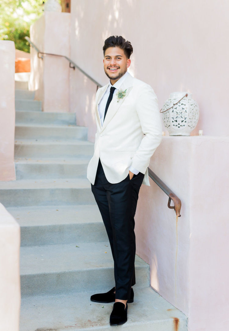 a dapper groom's look with black velvet moccasins and no socks