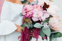 22 a vibrant bouquet with king proteas, pink orchids, amaranth and fresh greenery for a textural look