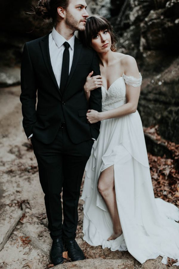 a romantic off the shoulder sweetheart neckline wedding dress with a side slit and a lace bodice