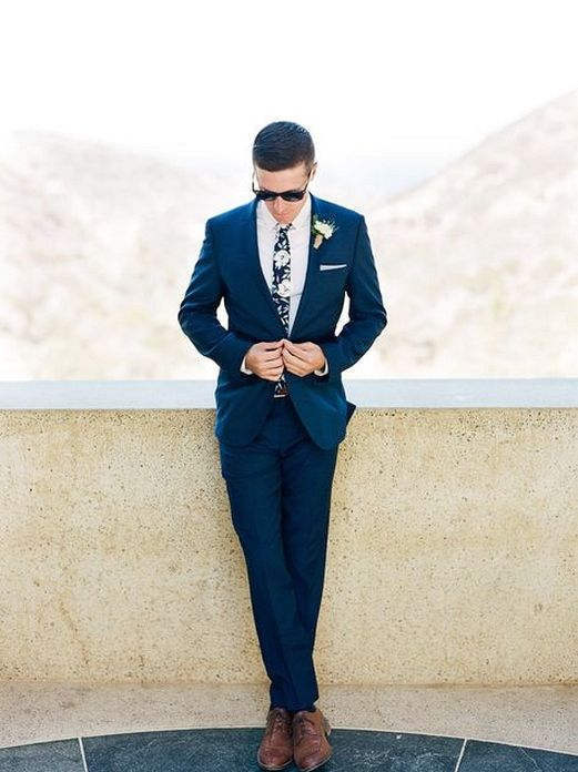 a stylish tropical groom look with a navy suit, a white shirt and a dark floral tie