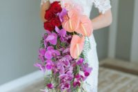 23 a vibrant cascading wedding bouquet with red roses, pechy callas and hot pink orchids for a bold statement
