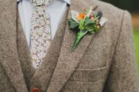 24 a light brown three-piece wool suit  with a floral tie and amber buttons is ideal for winter