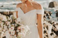 24 a simple off the shoulder V-neckline A-line wedding dress for a coastal bride