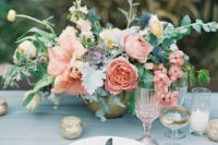 24 a soft centerpiece with peonies, ranunculus, succulents and textural greenery
