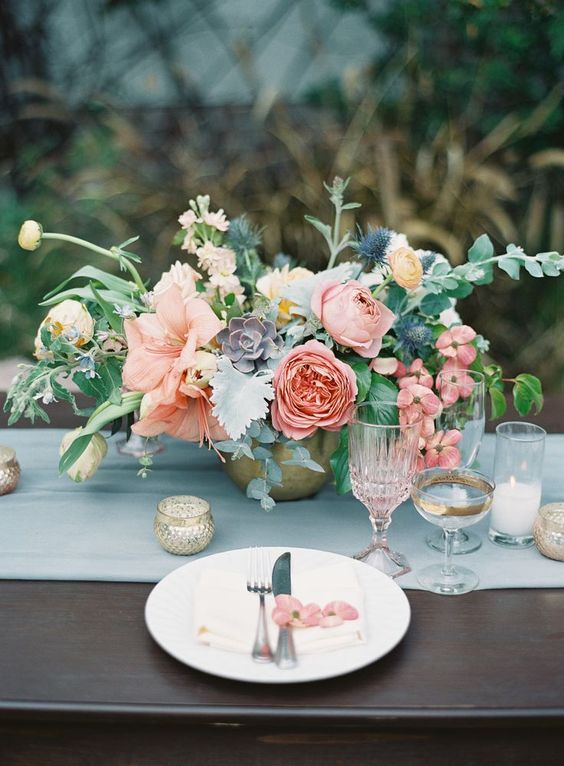 a soft centerpiece with peonies, ranunculus, succulents and textural greenery