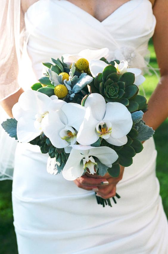 a whimsy bouquet of white orchids, succulents and billy balls for a unique touch