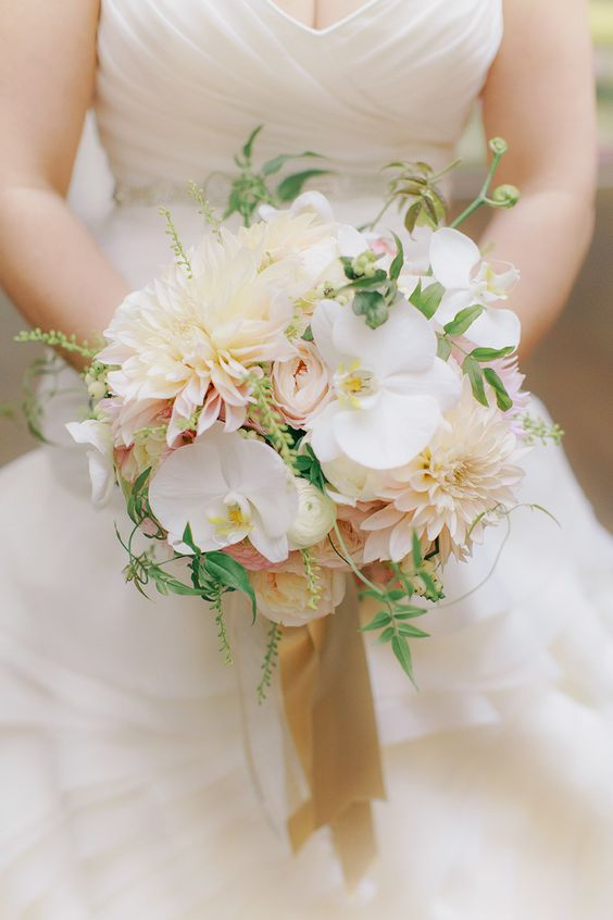a whimsy wedding bouquet with ivory dahlias, pink garden roses and white orchids plus greenery
