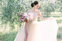 25 an ethereal off the shoulder blush wedding dress with an A-line silhouette