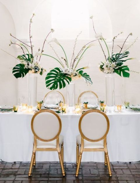 Picture Of Gorgeous Tropical Centerpieces With Blooms And Palm Leaves For A Glam Or Art Deco Wedding