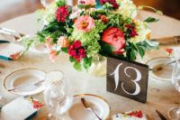 26 a super colorful centerpiece with red peonies, pink and green blooms and greenery