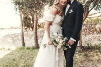 26 an off the shoulder lace A-line wedding dress with floral appliques and a small train for a romantic look