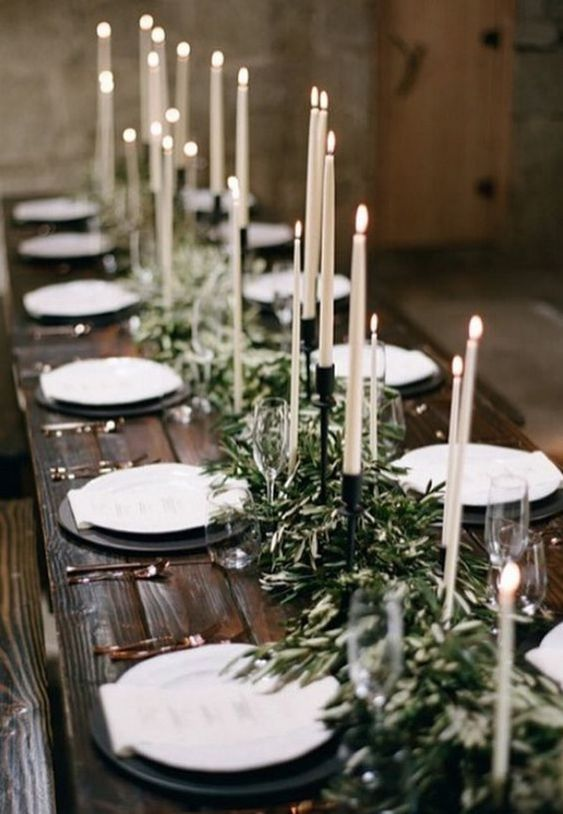 an olive branch wedding table runner with tall candles is an elegant and chic idea suitable for many weddings