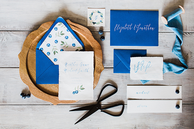 The wedding stationery was done with bold blue envelopes, with painted blueberry and blue calligraphy