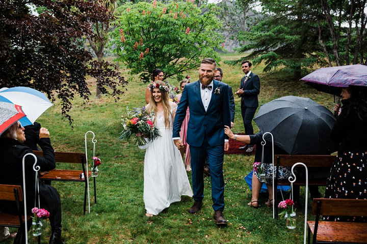This couple went to the bride's home in New Zealand to celebrate their backyard wedding
