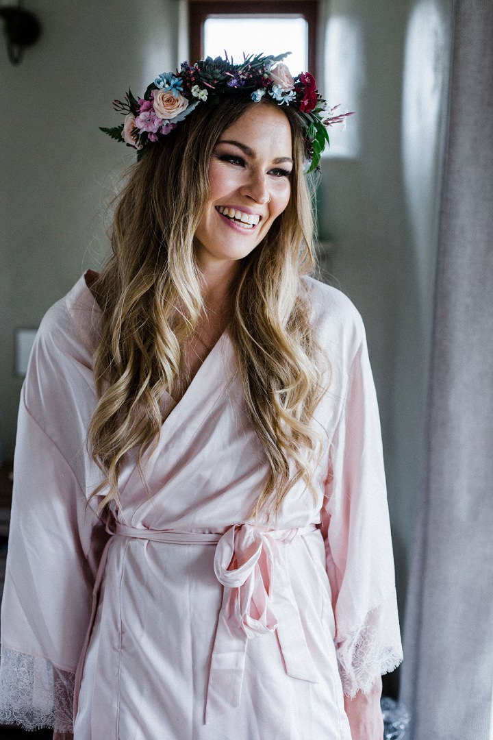 The bride was rocking a bright floral crown and waves down for a romantic look