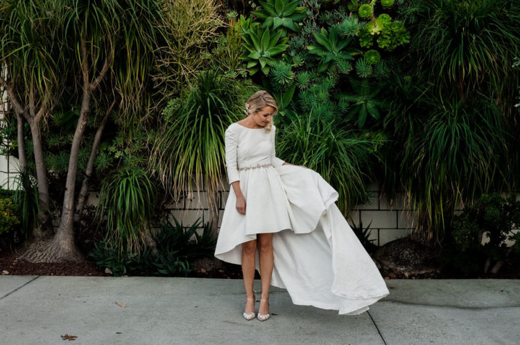 The bride was wearing a playful high low dress with a small train, which allowed to show off the shoes