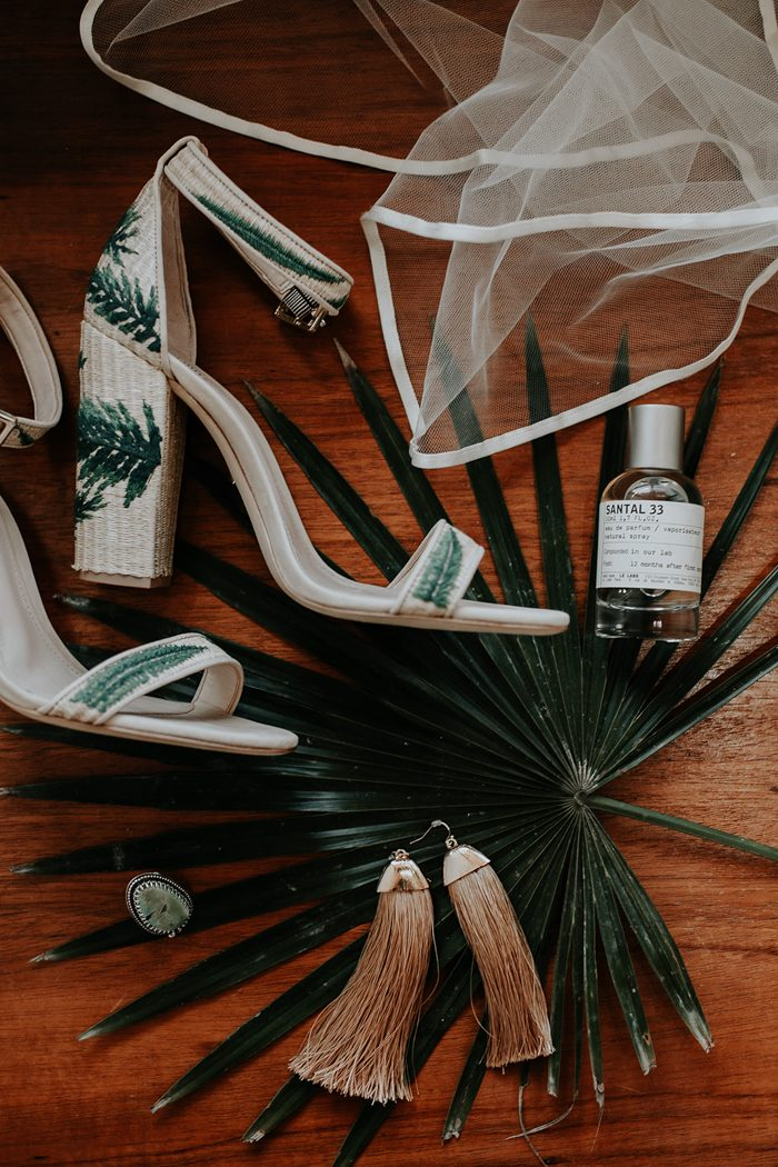 The bride was wearing amazing heels with embroidered torpical leaves on them and glam tassel earrings