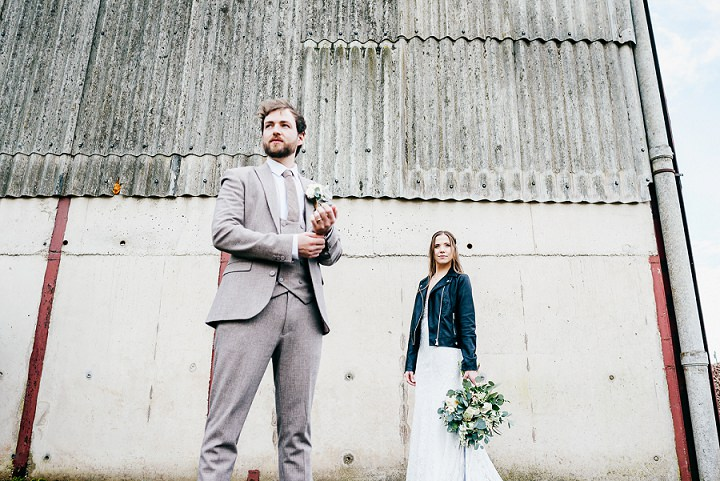 The groom was rocking a grey printed three-piece suit with a matching tie