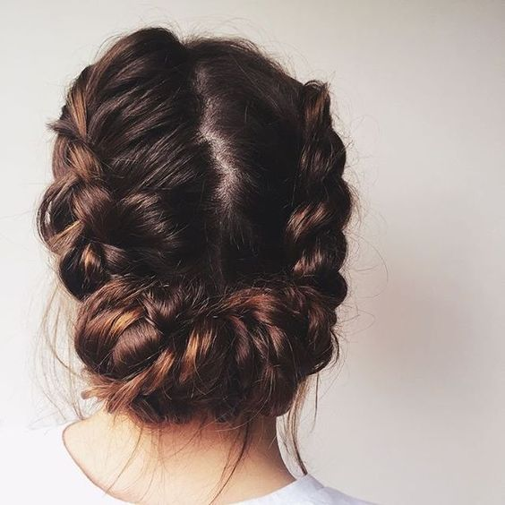 a cool braided low updo with a texture looks cool for a rustic or boho bride