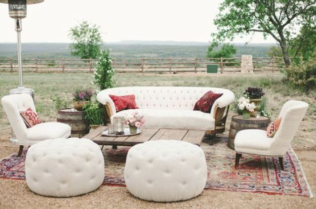 a rustic and boho lounge with gorgeous creamy furniture and pallet items for a cozy feel