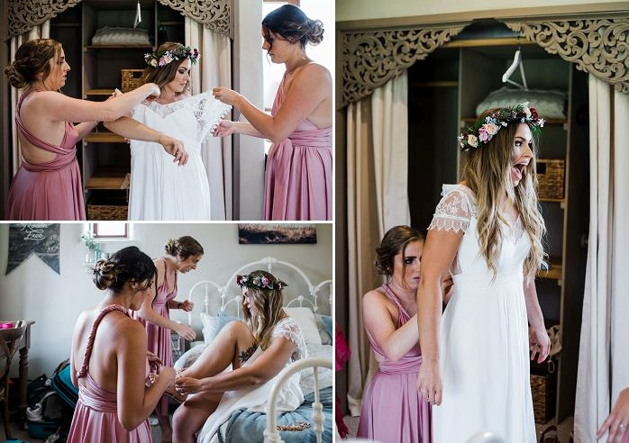 She was wearing a chic boho lace wedding gown with a cutout back and the bridesmaids were rocking dusty pink knee gowns