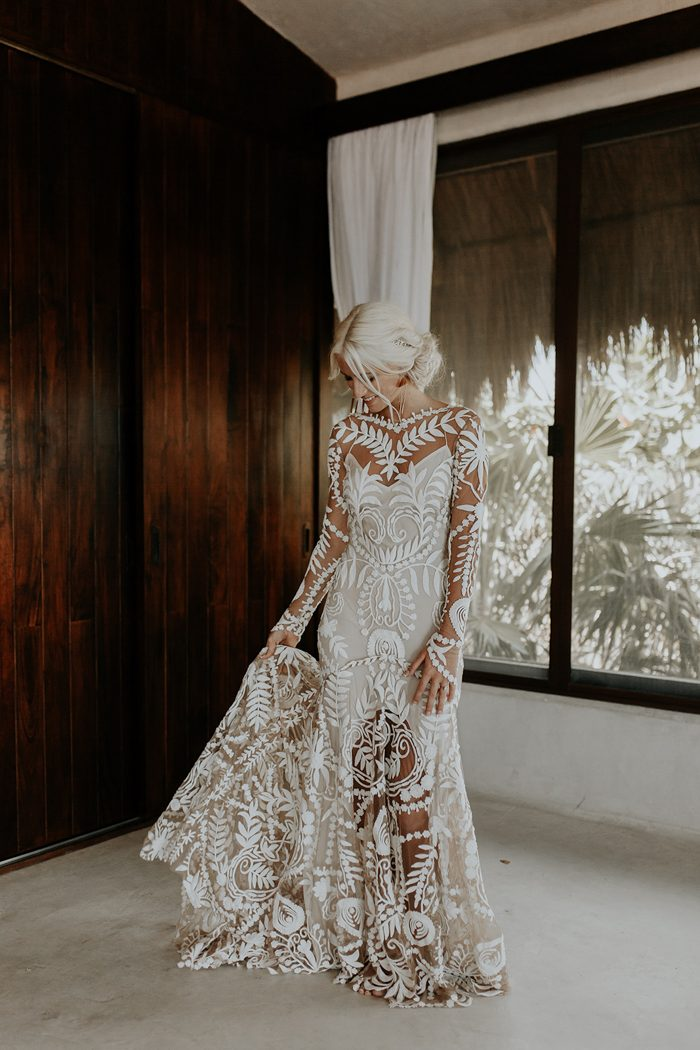 She was wearing a stunning Rue De Seine wedding dress with a train and a slip underdress