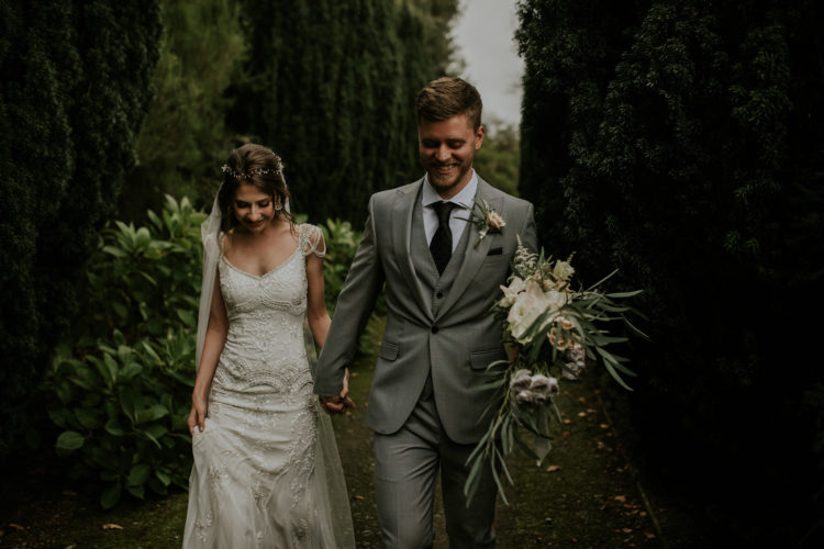The groom was wearing a three-piece grey suit with a dark printed tie