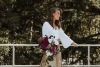 03 The second bride preferred a white top with bell sleeves and a gold glitter skirt with a train