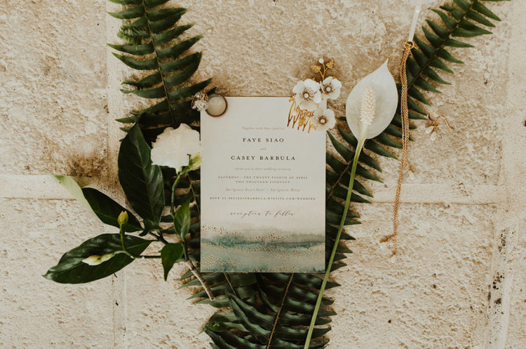 The wedding invitations were done with green watercolor and gilded touches to embrace the location