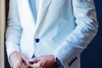 03 a beach groom's look with a white suit, a blue shirt and navy buttons and no tie